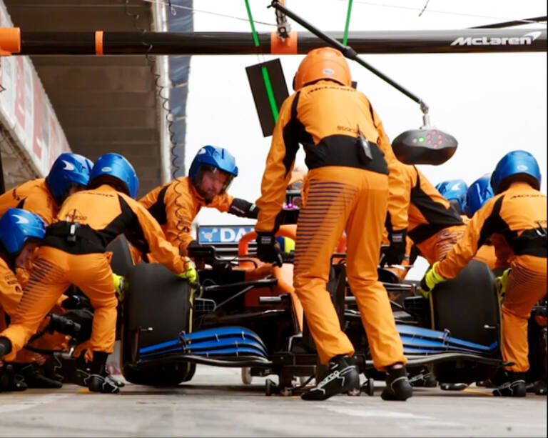 Mc Laren pit crew in action Mobile